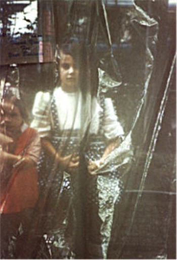 A family photo of two girls projected onto loosely drapped plastic