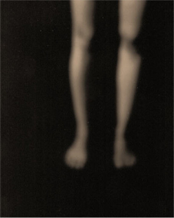 Blurry legs on a black background